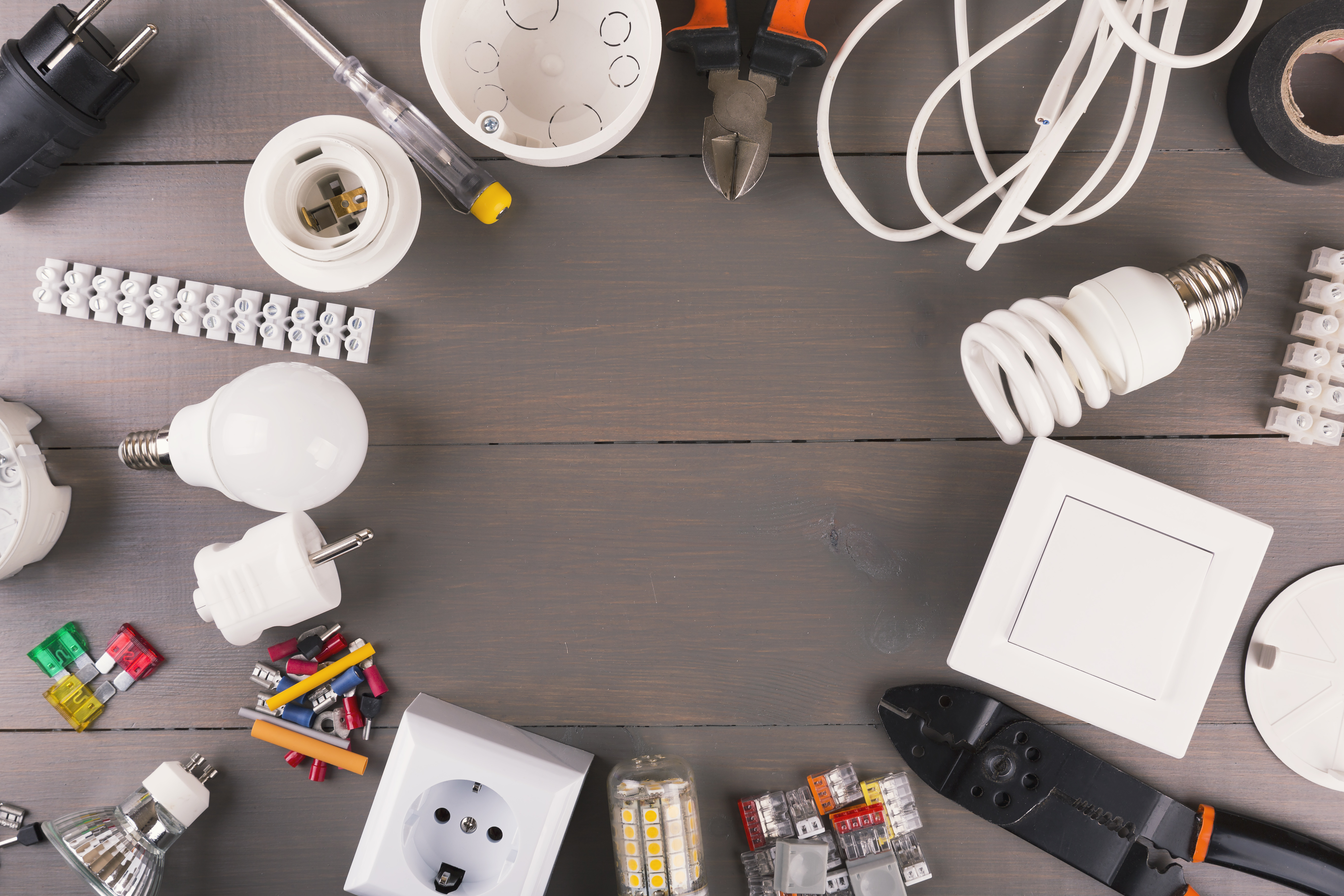 top view of electrical tools and equipment on gray wooden table